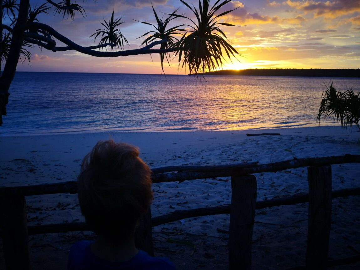 Beautiful sunrise over Tutuala Beach and Jaco Island, with my brother looking on in the foreground.
