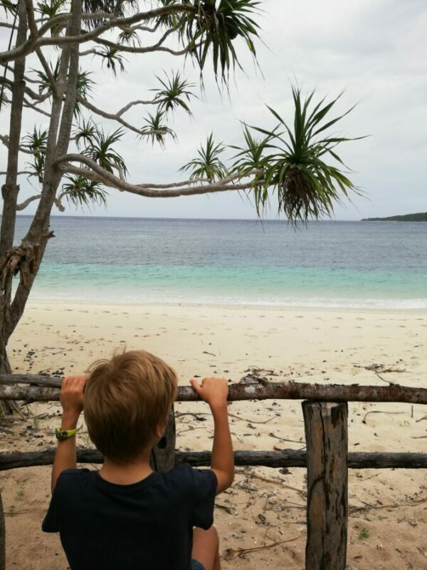 My little brother looking at the layered blues of the ocean from the sands of Tutuala Beach.