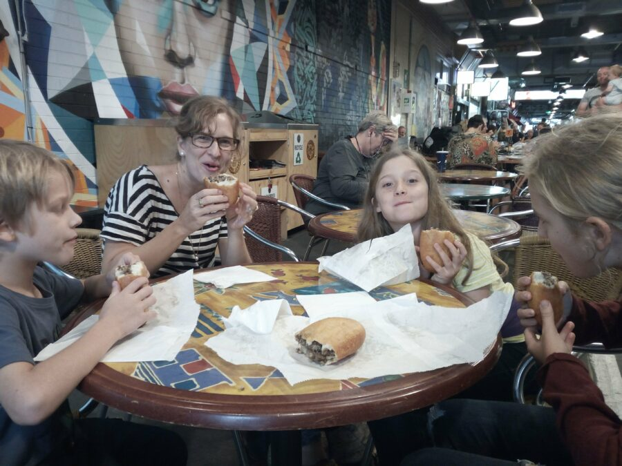Eating piroshki in Adelaide Central Market.