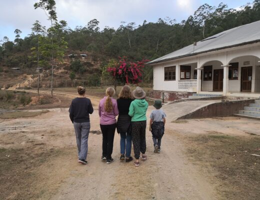 Family walking on a dirt path